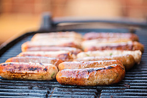 Beef and pork sausages on grill or barbecue